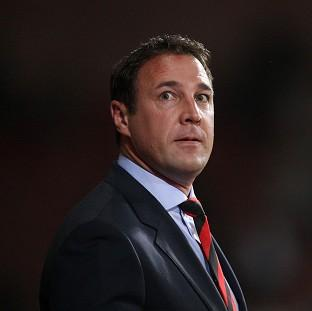 Malky Mackay has apologised for sending three offensive texts
