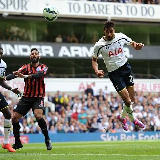 Tottenham's Nacer Chadli, right, heads in