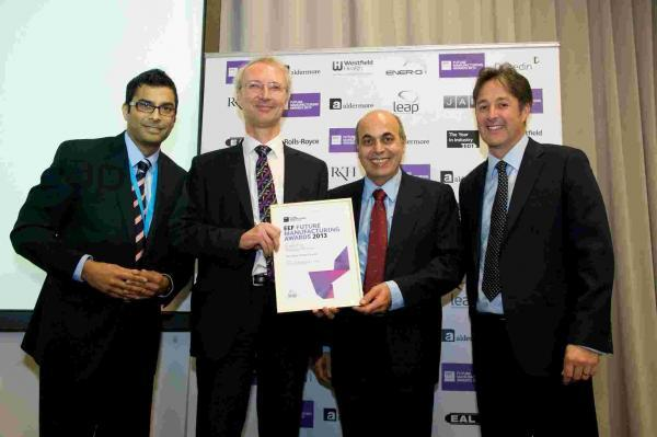 In the centre, Stephen Blatchford and Saeed Zahed with one of their EEF Manufacturing Awards last year