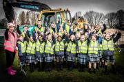 Headmistress Pim Grimes, along with students and staff from St Swithun's School and employees from Feltham Construction celebrate the start of the construction of the new junior school