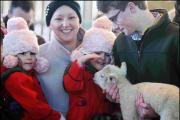 Twins Summer and Georgia Roach, 4, meet a new lamb
