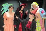 Evelyn the Wicked Witch  Sarah Litton) with her daughter Lil Eve, with Princess Lottie (Catharine Cartwright) and Nick (Peter Grace) in scene from Once Upon a Time at King's Somborne