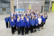 A team of Year 5 pupils are outside the new school building which was built in 2012 after years of planning.