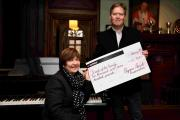 Viv Wheeler, Friends of the Family chair of trustees, accepts a £10,900 cheque from Will Beardmore-Gray