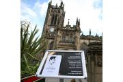 The order of service on a sign outside Manchester Cathedral ahead of the memorial for Coronation Street star Anne Kirkbride