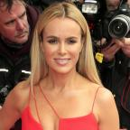 Hampshire Chronicle: Amanda Holden lies naked on a bed of cabbages for Peta