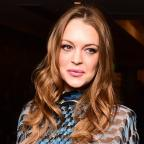 Hampshire Chronicle: Lindsay Lohan says she is 'good and well' after police kick door in after lovers' row