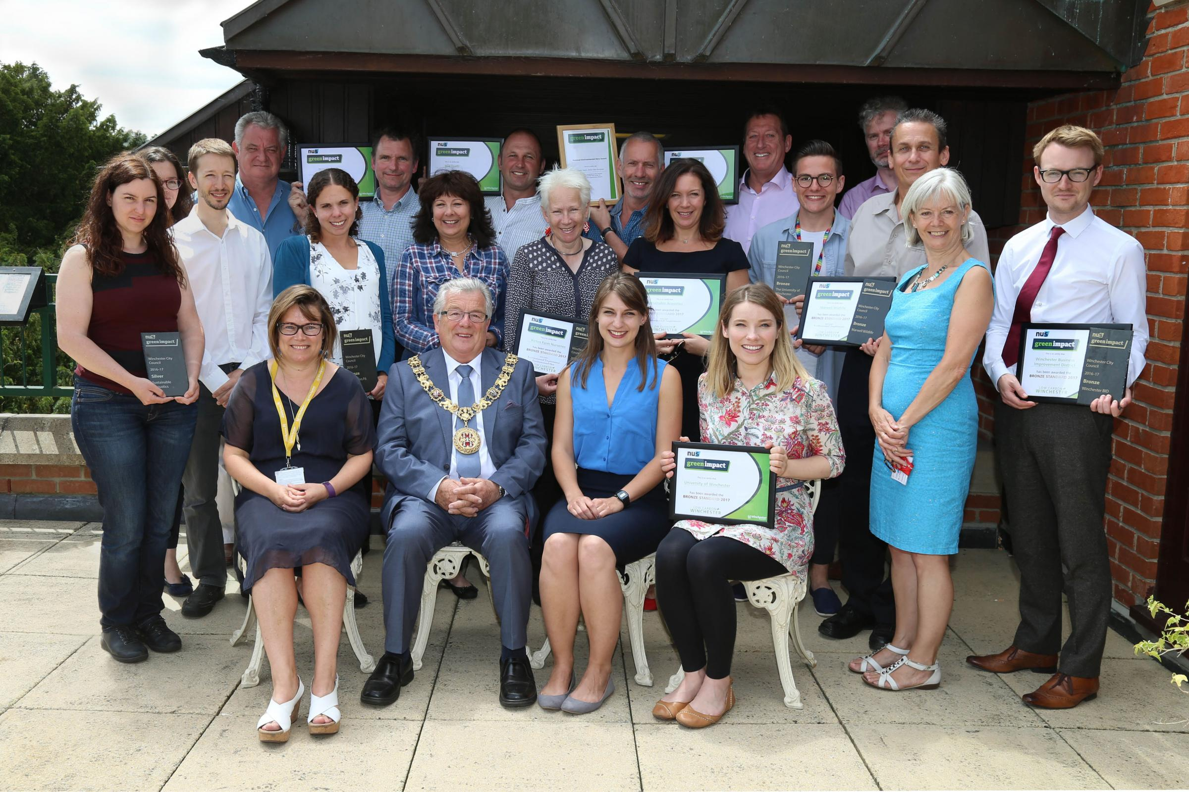Mayor of Winchester,  Cllr David McLean, with the first businesses who have received Green Impact, Winchester City Council's new green business scheme