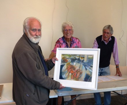 "Keith Bennett handing in his painting ""King Prawn Starters"" for the selection process for Winchester Art Club's 90th Annual Exhibition. Also shown are club chairman Hilary Armstrong and committee member Chris Sealey."