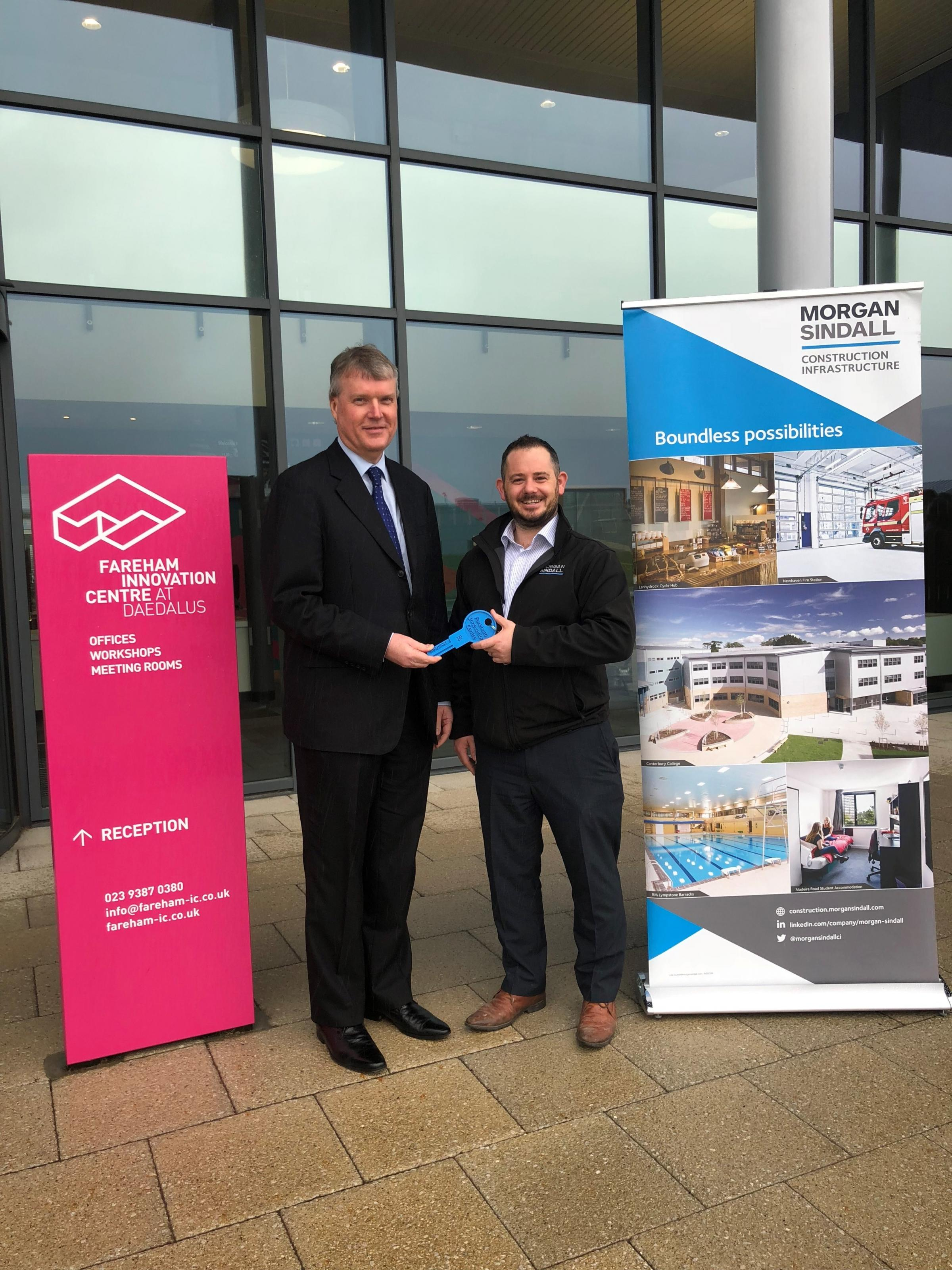 Cllr Sean Woodward receives the keys to the Fareham Innovation Centre extension from Mike Day, project manager for builders Morgan Sindall