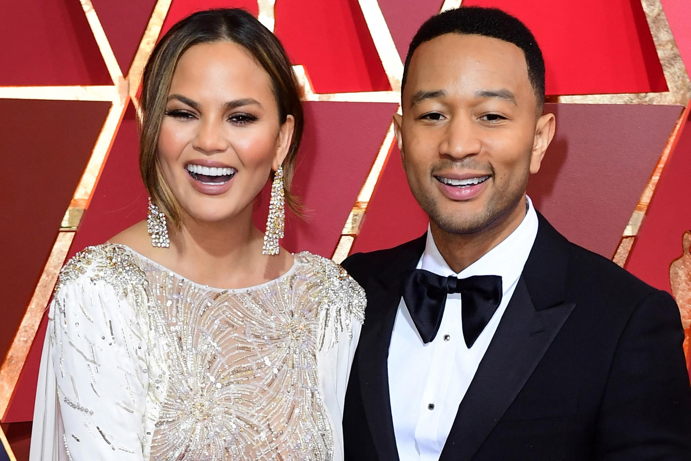 Chrissy Teigen and John Legend (PA)