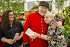 Sparsholt student Lucy Phalp and veteran Gill Parker with Chelsea Pensioner Credit: Stewart Turkington