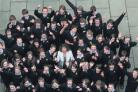 TRIPLE TIME: School head Susan Trigger with pupils. Picture: Stuart Martin Order no: 8302882