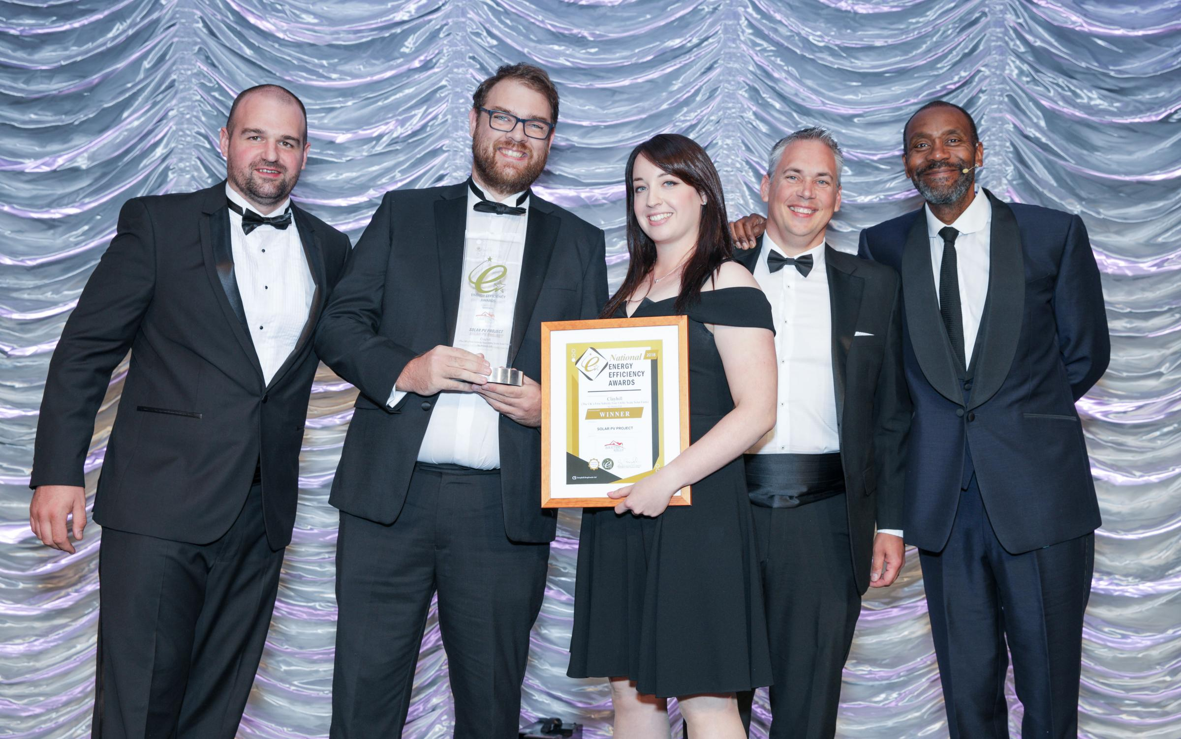 The Anesco team receiving their award from TV's Sir Lenny Henry