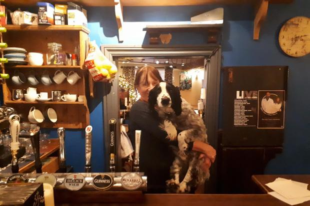 The Hyde Tavern, Winchester, landlady Janet Theodore with pub dog, Jim