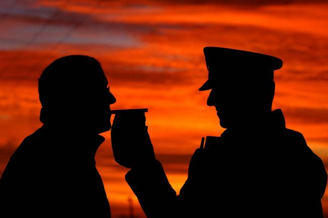 Embargoed to 0001 Tuesday December 11..File photo dated 30/11/06 of a motorist stopped by police taking a breath test as almost 20% of motorists have taken a risk by drink-driving at Christmas, according to an AA/Populus survey. PRESS ASSOCIATION Photo. I