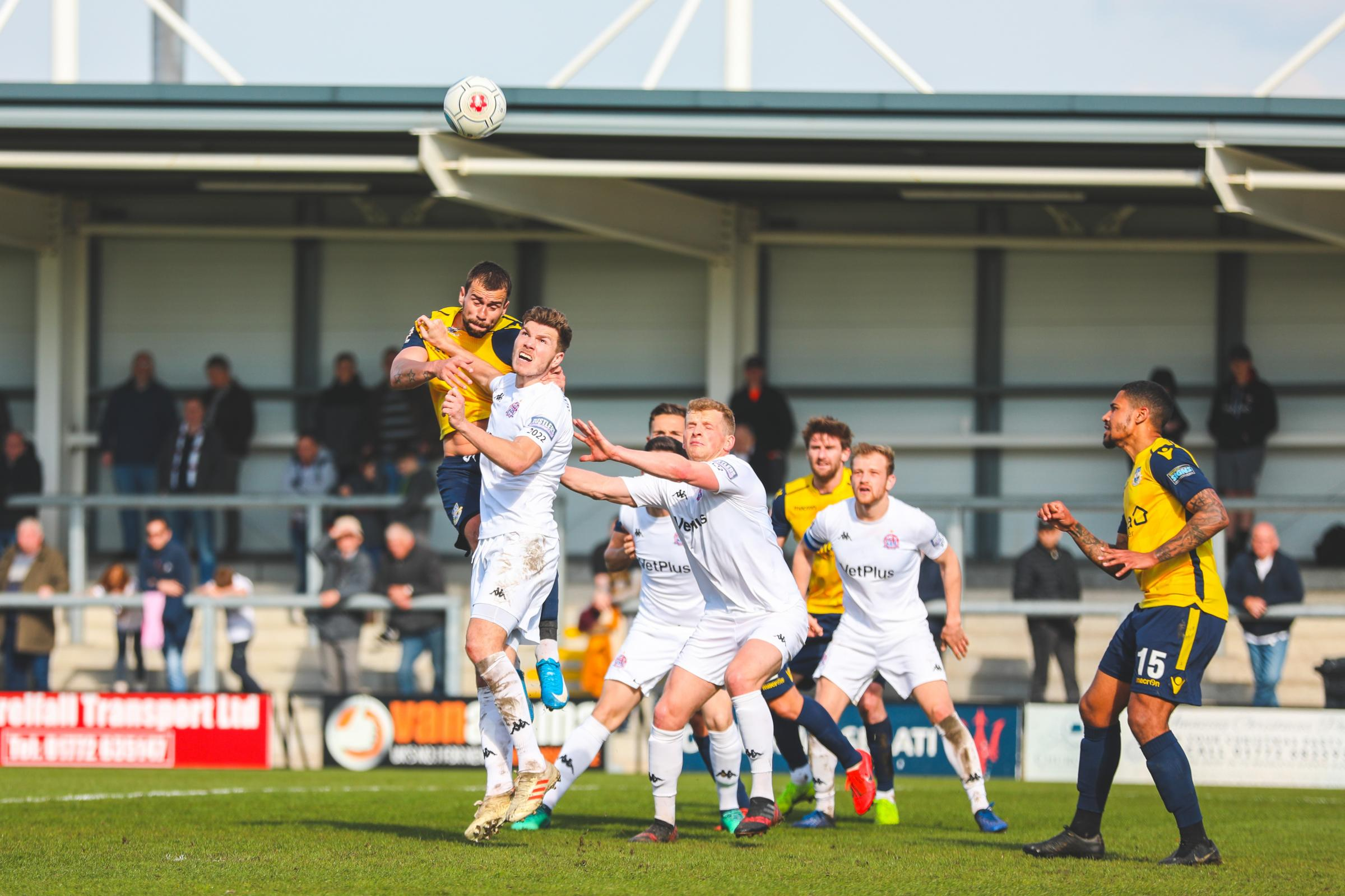 Eastleigh's Andrew Boyce goes up for a header at Fylde (photo: Tom Mulholland)