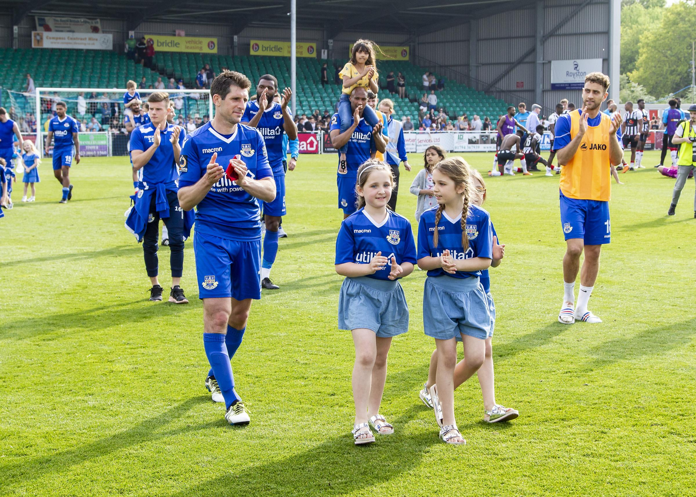 Eastleigh skipper Danny Hollands leads the team on a lap on honour on Monday (photo: Graham Scambler)