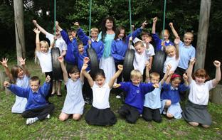 Hampshire Chronicle: DOING GREAT: Head teacher Lou Stapleton celebrates with pupils.               Echo picture by Malcolm Nethersole. Order no: 8912099