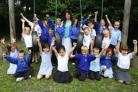 DOING GREAT: Head teacher Lou Stapleton celebrates with pupils.               Echo picture by Malcolm Nethersole. Order no: 8912099